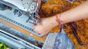 sew the sleeves with the kurti matching right to right